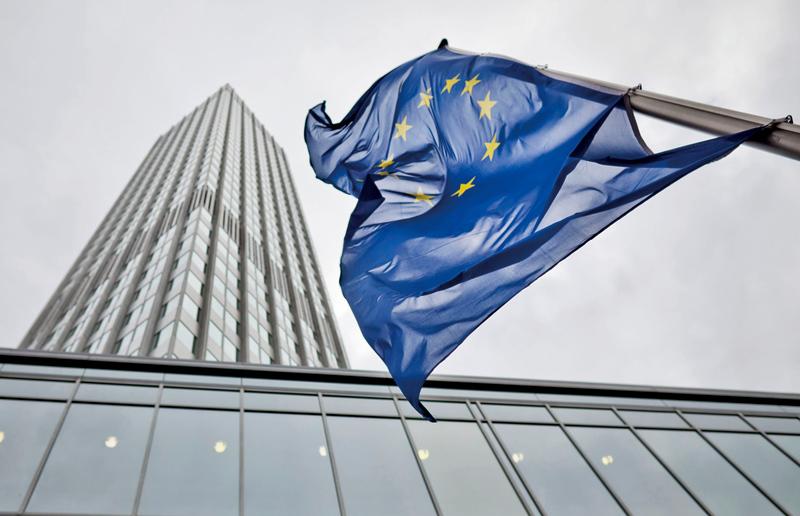 歐元集團希望能儘快完成對希臘的經改方案審查,以便繼續提供希臘紓困金援,償付將到期的歐洲央行債務。圖為位於法蘭克福的歐洲央行。(AFP)