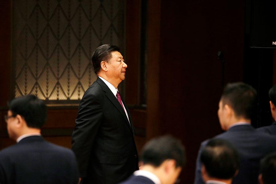 新華網主題文章述及習近平與海南40年超過海南建省時間,除了為習近平立威,背後也不無「去江」之意。(JASON LEE/AFP/Getty Images)