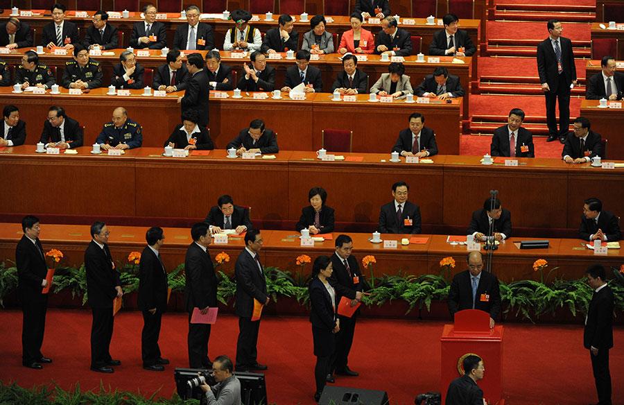 中國超級富豪們的政治運氣急劇逆轉,他們今年在全國人大當中的席位大幅減少。這反映出在習近平時代,中國超級富豪們的地位下降。(MARK RALSTON/AFP/Getty Images)