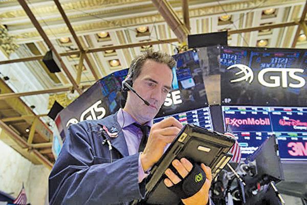 美國企業去年第四季錄得了近年來亮麗的財報,但今年以來股價卻表現平平。(AFP)