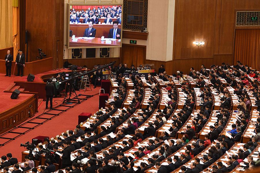 圖為3月5日中共人大會議開幕現場。(GREG BAKER/AFP/Getty Images)