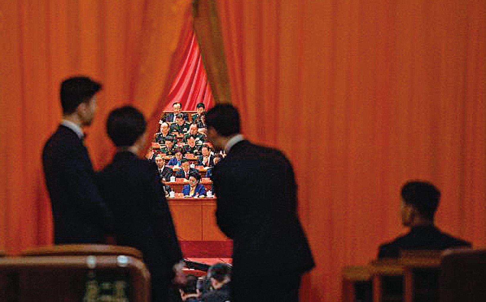 3月11日下午,中共全國人大代表表決修憲草案現場。(FRED DUFOUR/AFP/Getty Images)