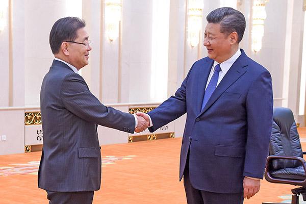 3月12日,南韓國家安保室室長鄭義溶和中國國家主席習近平見面。(Getty Images)