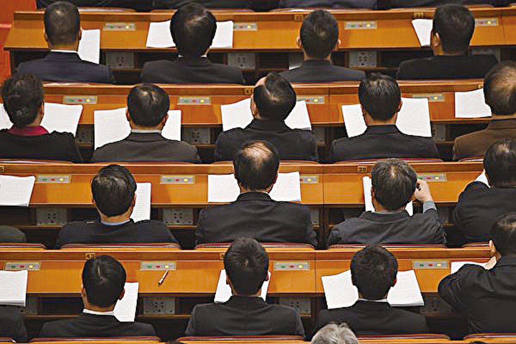 全國人大會議聽取國務院機構改革方案。(GREG BAKER/AFP/Getty Images)