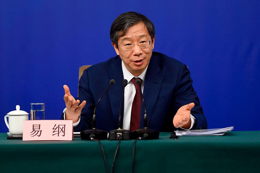 中共國務院新內閣結果19日公佈,中共央行副行長、中央財經辦副主任易綱升任央行行長。(WANG ZHAO/AFP/Getty Images)