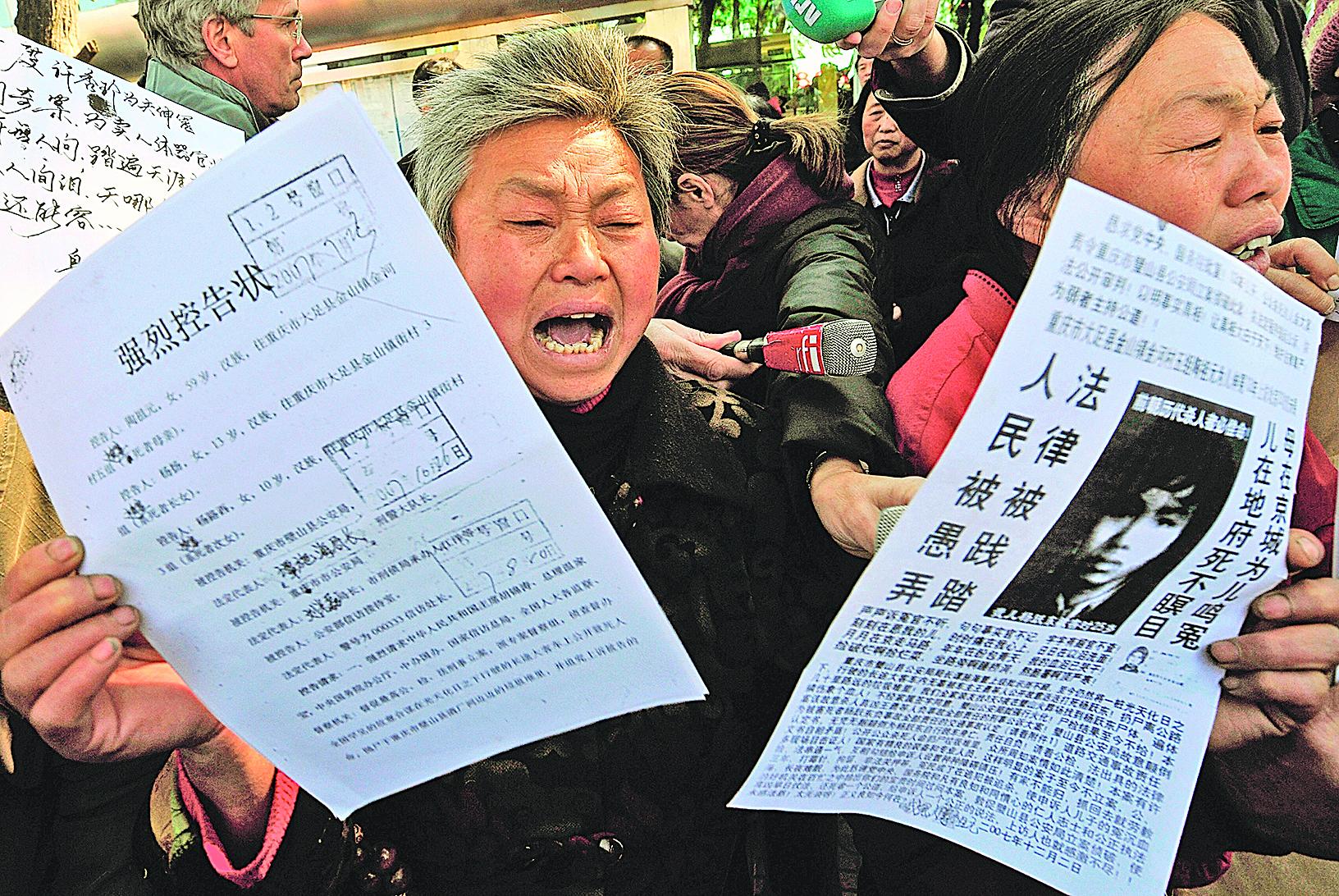 圖為在北京上訪喊冤的中國訪民。(Getty Images)
