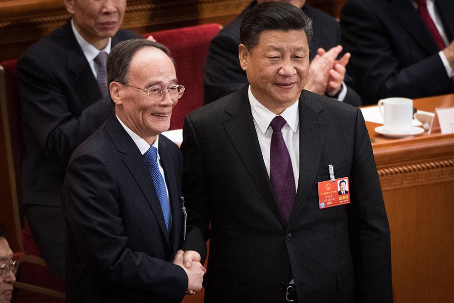 王岐山當選國家副主席,與習近平形成「習王體制」。(NICOLAS ASFOURI/AFP/Getty Images)