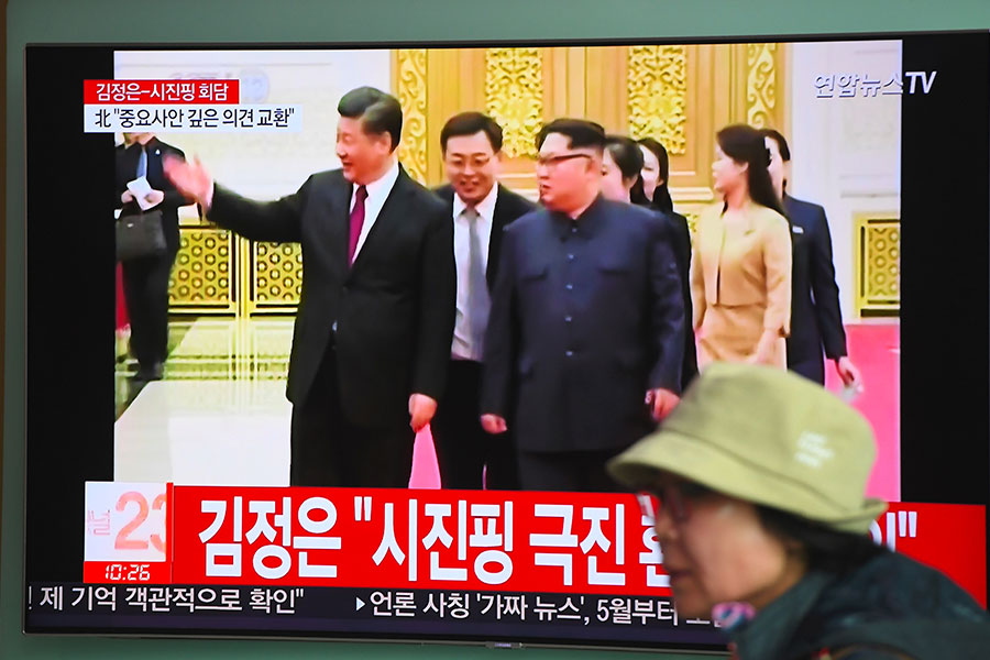 圖為韓媒報道習金會的電視畫面。(JUNG YEON-JE/AFP/Getty Images)