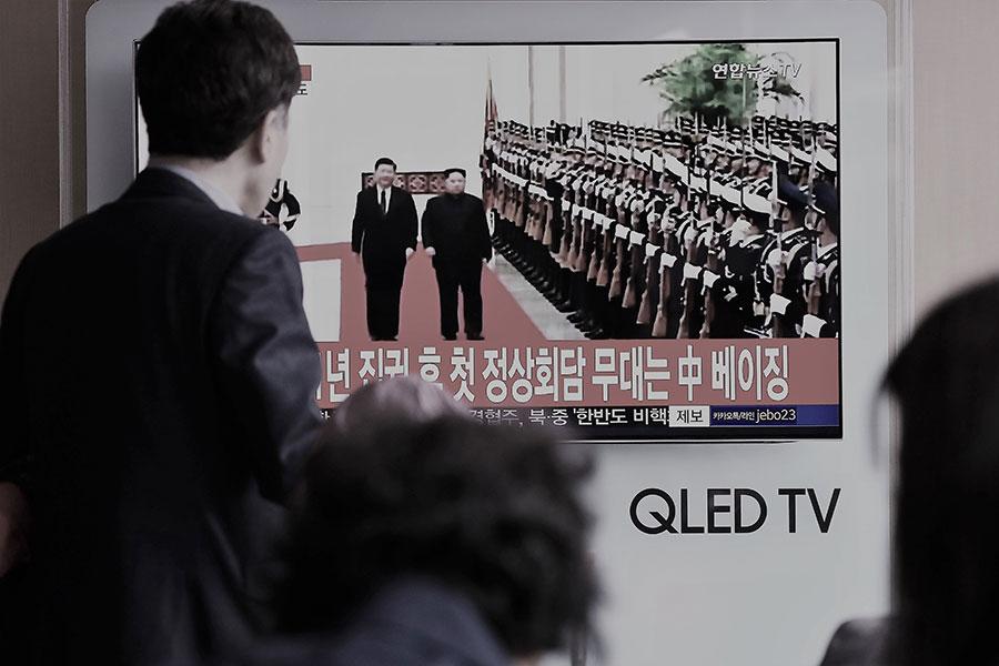金正恩3月25日至28日訪華時,僅有三名中共政治局常委會見了金正恩。(Chung Sung-Jun/Getty Images)