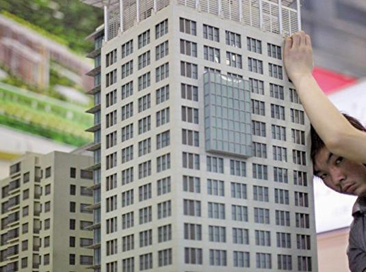 近日,一向唱衰大陸樓市的經濟學家謝國忠也改口鼓勵大家買房,稱調控是買房信號。(AFP)