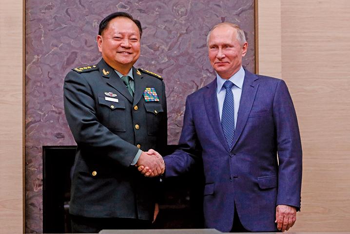 為查軍委主席負責制的執行等情況,中共軍委副主席張又俠(左)將負責此次軍隊巡視工作。(Getty Images)