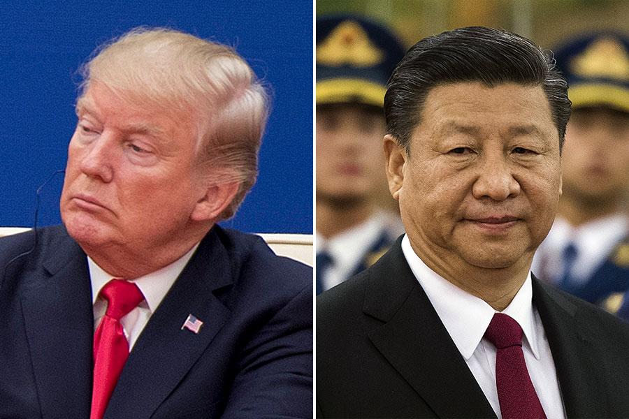 有專家指出,中美貿易問題的根源是非關稅「貿易壁壘」,是中共前黨魁江澤民執政時期遺下的「惡果」。(JIM WATSON, NICOLAS ASFOURI/AFP/Getty Images)
