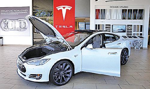 中國開放汽車市場,第一個得益的令人聯想到美國的TESLA。(Justin Sullivan/Getty Images)