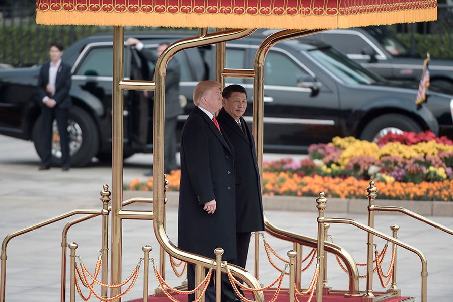 習近平在博鰲論壇上發表演講,提出開放大門和四方面舉措。圖為特朗普和習近平2017年11月在北京。(FRED DUFOUR/AFP/Getty Images)
