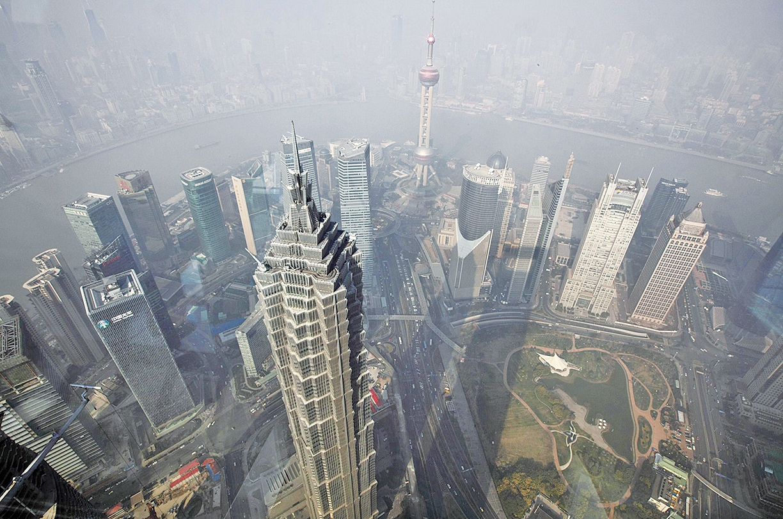上海是中國的經濟、金融中心,「上海幫」要員紛紛被調離,習家軍全面接管上海,標誌著江澤民的政治老巢被攻陷。(大紀元資料室)