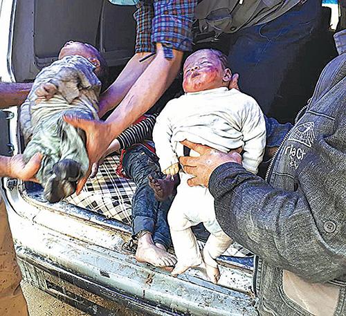 4月9日,化武攻擊後兒童的遺體。(大紀元資料室)