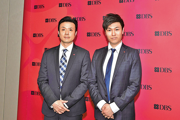 星展高級經濟師周洪禮(左)和經濟師謝家曦(右)(郭威利/大紀元)