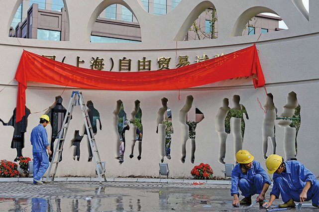 習推海南自貿區與自由港,倒逼上海自貿區加速變革,也為清洗江派政商利益圈埋下伏筆。(Getty Images)