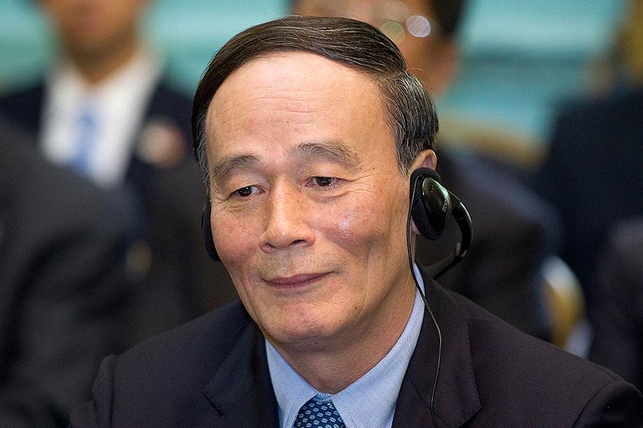 日本媒體在報道中指出,中共最近的外交動作,都是來自中共國家副主席王岐山的指令。(Simon Dawson/AFP/Getty Images)