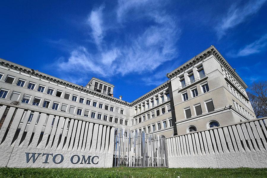 中美貿易衝突之際,原本平淡無奇的世貿相關委員會的例行會議,意外成為關注焦點,特別是本周召開的保障措施委員會。圖為位於瑞士日內瓦的世貿總部。(FABRICE COFFRINI/AFP/Getty Images)
