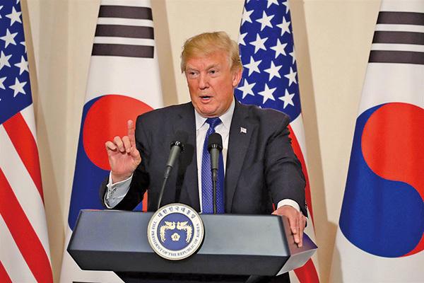 美國總統特朗普上周六晚在密歇根州的一次集會上表示,他與金正恩的峰會「將在未來三到四周舉行」。(Scott Olson/Getty Images)