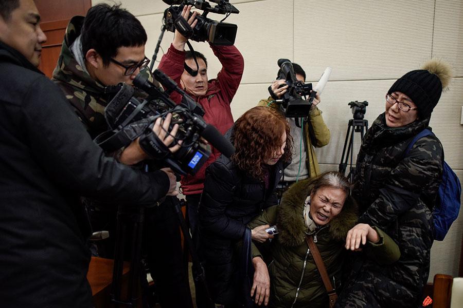 中國記者的「禁區」很多,諸如宗教、軍事、間諜、強拆、涉貪以及群體性事件,這些都不能報道。(FRED DUFOUR/AFP/Getty Images)