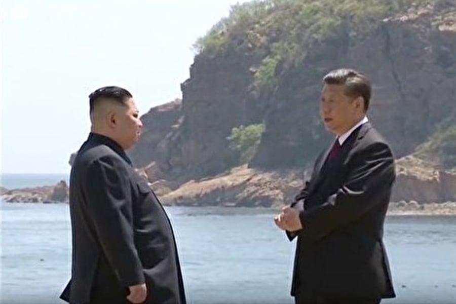 5月8日,金正恩與習近平在中國大連棒槌島會晤。(視像擷圖)