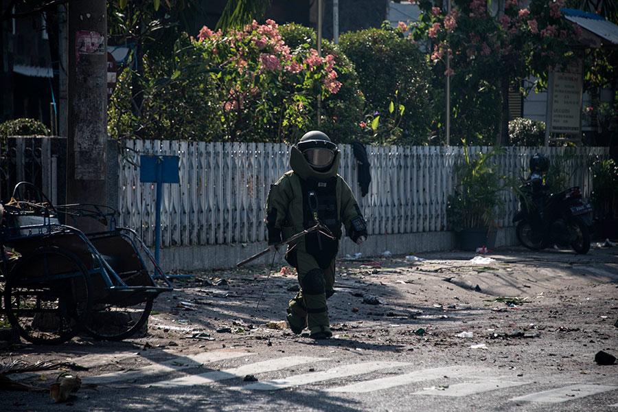 2018年5月13日,印尼爪哇島第二大城泗水的三間教堂幾乎在同一時間遭到自殺炸彈襲擊,造成至少9死、40傷。(JUNI KRISWANTO/AFP/Getty Images)