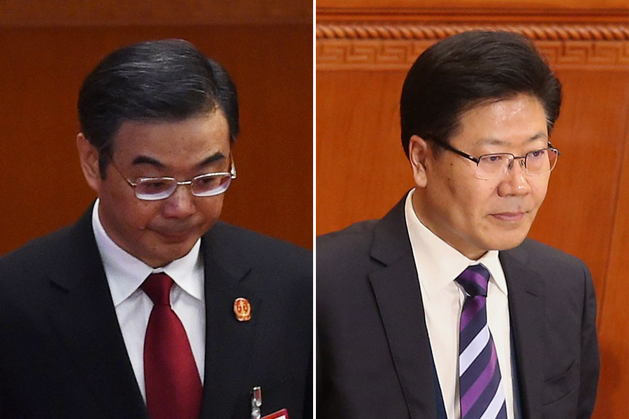圖為周強(左)與張春賢。(Feng Li, GREG BAKER/AFP/Getty Images)