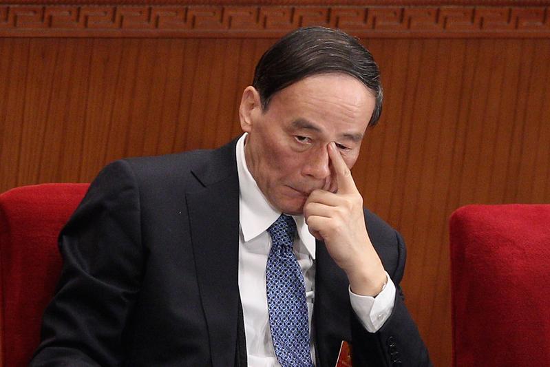 王岐山任中共中央外事工作委員會委員,排在該委員會主任習近平、副主任李克強之後。(Feng Li/Getty Images)