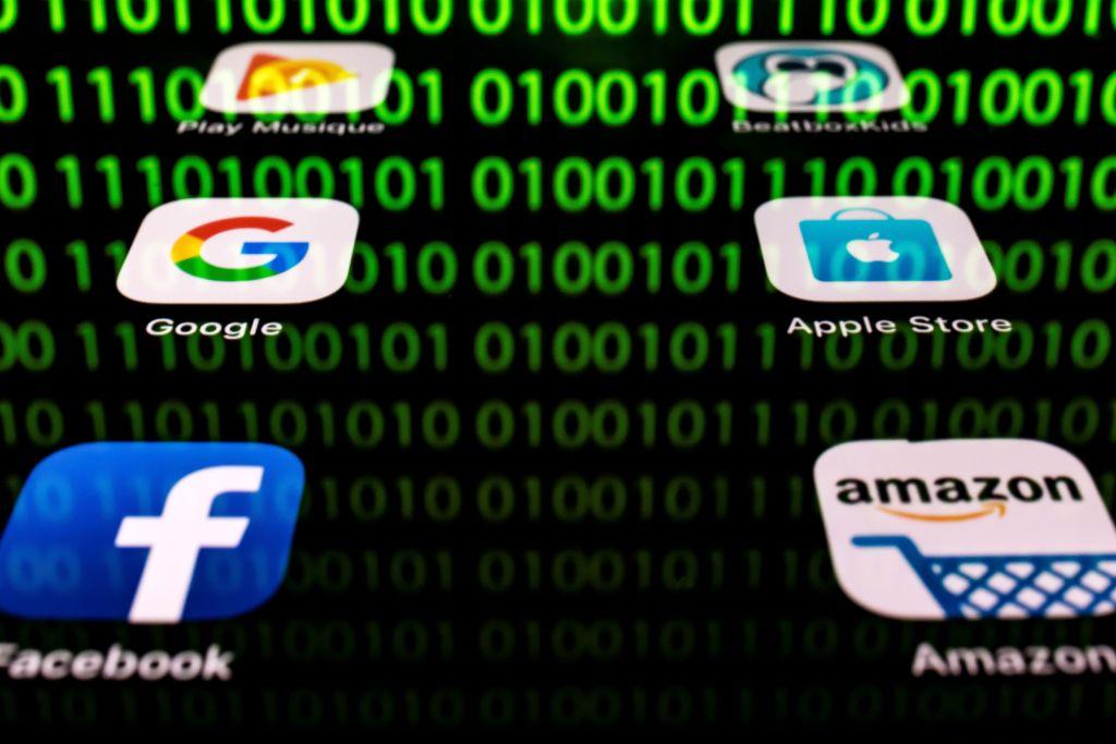 繼Facebook承認向中國公司提供用戶資料受到美國國會關注之後,美國國會開始審查谷歌公司和中國科技公司之間的合作。(LIONEL BONAVENTURE/AFP/Getty Images)