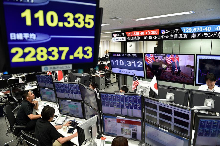 特金會今早舉行,日經指數上漲0.6%。(KAZUHIRO NOGI/AFP/Getty Images)