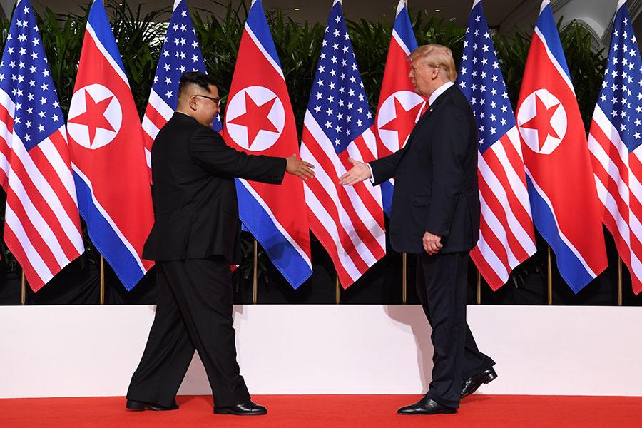 6月12日,特朗普和金正恩在新加坡聖淘沙的嘉佩樂酒店會面。(SAUL LOEB/AFP/Getty Images)