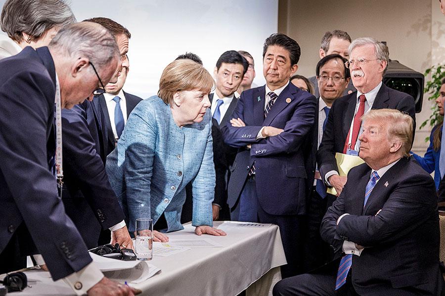 在6月12日特金會後的記者會上,美國總統特朗普對6月9日七國集團(G7)峰會一張網絡熱議的照片,做了詳細的說明。(Jesco Denzel /Bundesregierung via Getty Images)