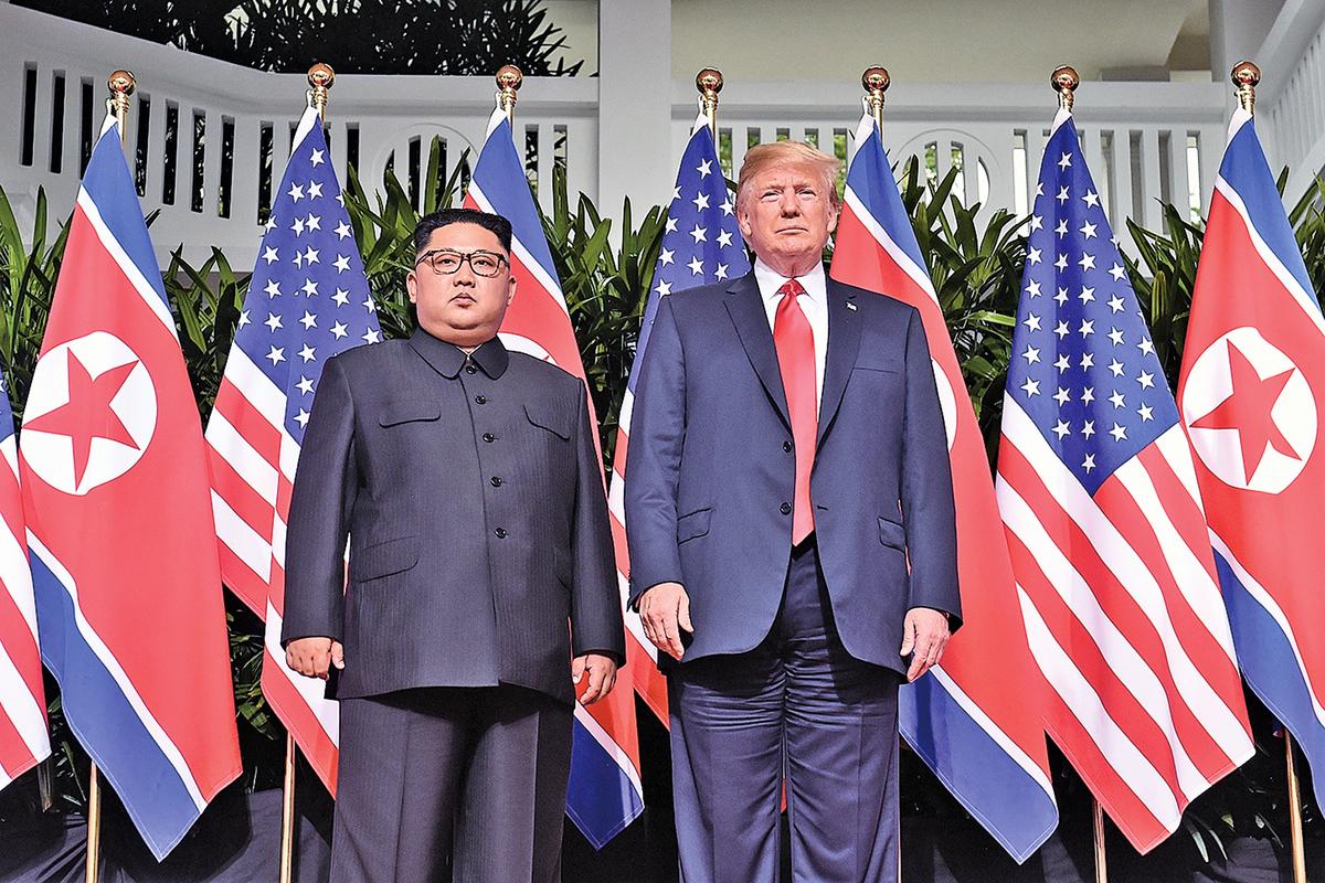 2018年6月12日,特朗普和金正恩在新加坡聖淘沙的嘉佩樂酒店會談無核化問題。(AFP)