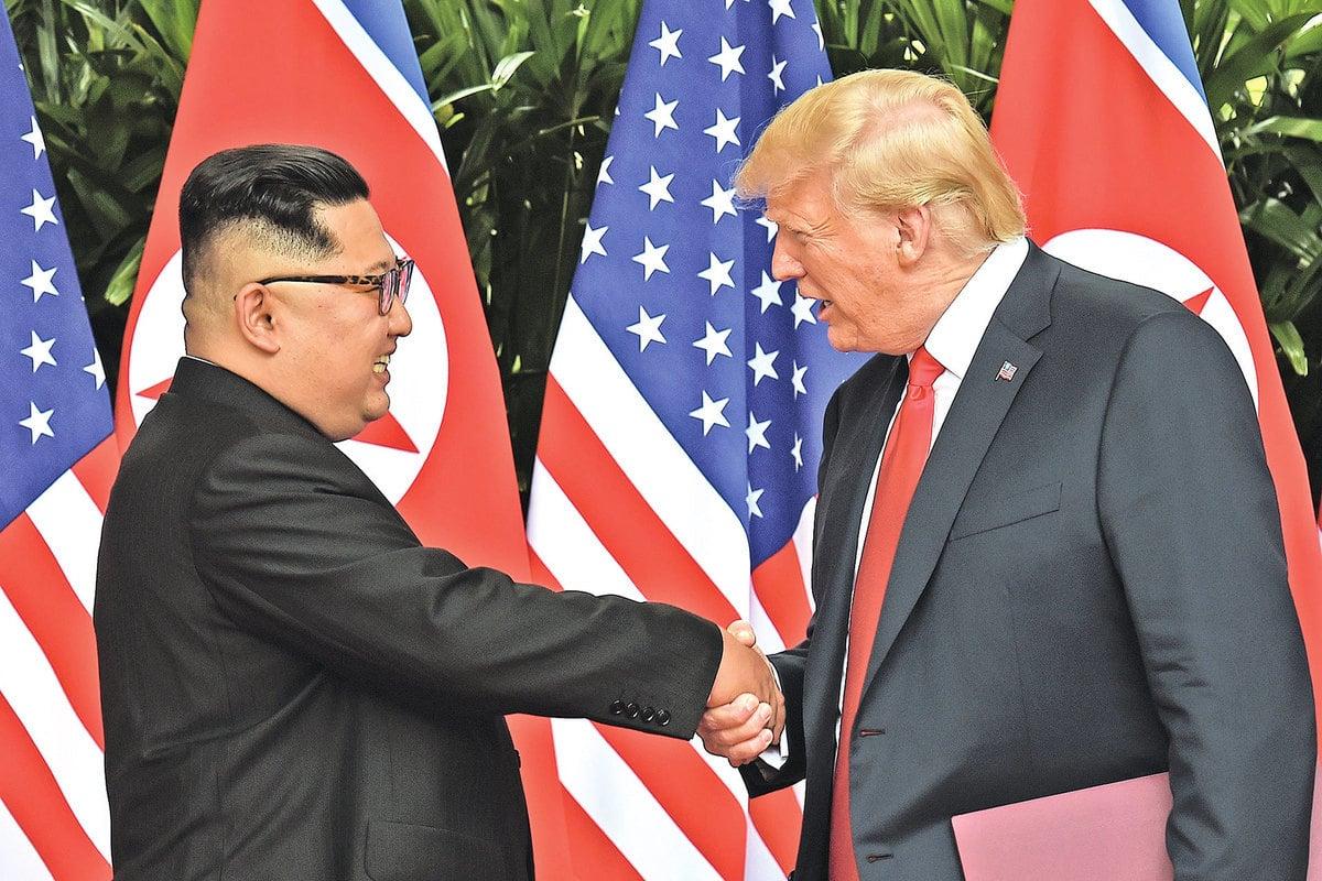 6月12日,特朗普總統與金正恩簽署聯合聲明。(SAUL LOEB/AFP/Getty Images)