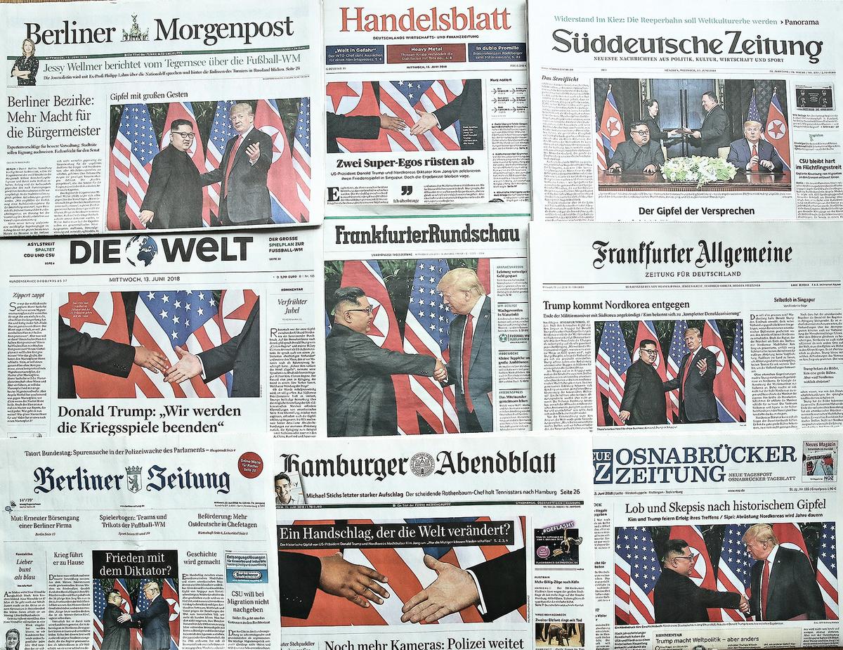 特金會全球矚目。圖為德國報紙6月13日的頭條報道。(Sean Gallup/Getty Images)