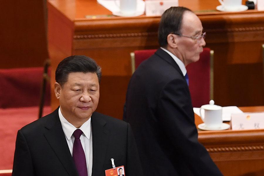習和王將展現一種全新的「習王體制」,頗有一種「焦不離孟,孟不離焦」的意味。(GREG BAKER/AFP/Getty Images)