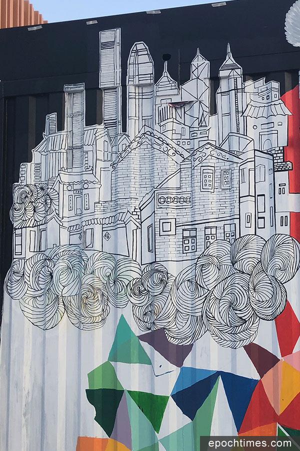 正在進行中的「盈豐匯滿錦添花」壁畫設計,將本港的現代高樓與圍村建築同時呈現在畫中,以表現傳統與現代的共融。(曾蓮/大紀元)
