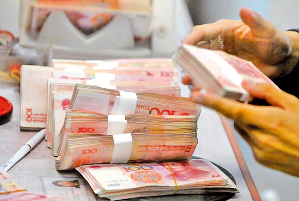 中共央行近日宣佈定向降準0.5個百分點,新措施將於7月5日生效。人民幣兌美元已經下跌到年內最低水平。(GettyImages)