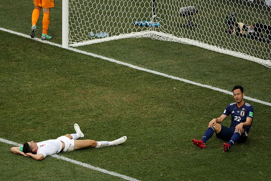 波蘭神鋒利雲度夫斯基(左)的世界盃之旅結束,他交出的成績單3場0球,確實扛不動波蘭隊。(Richard Heathcote/Getty Images)