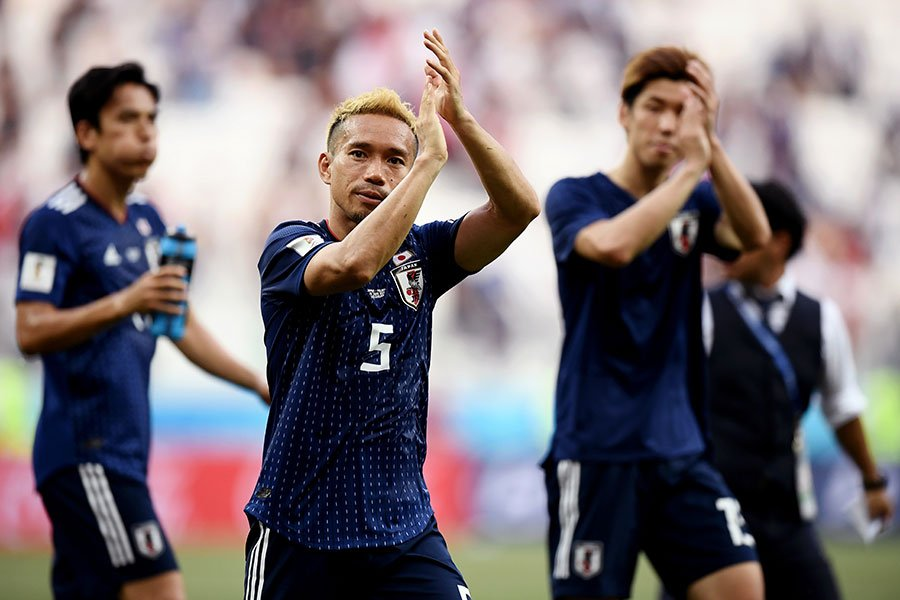 日本隊歡慶勝利。(Carl Court/Getty Images)
