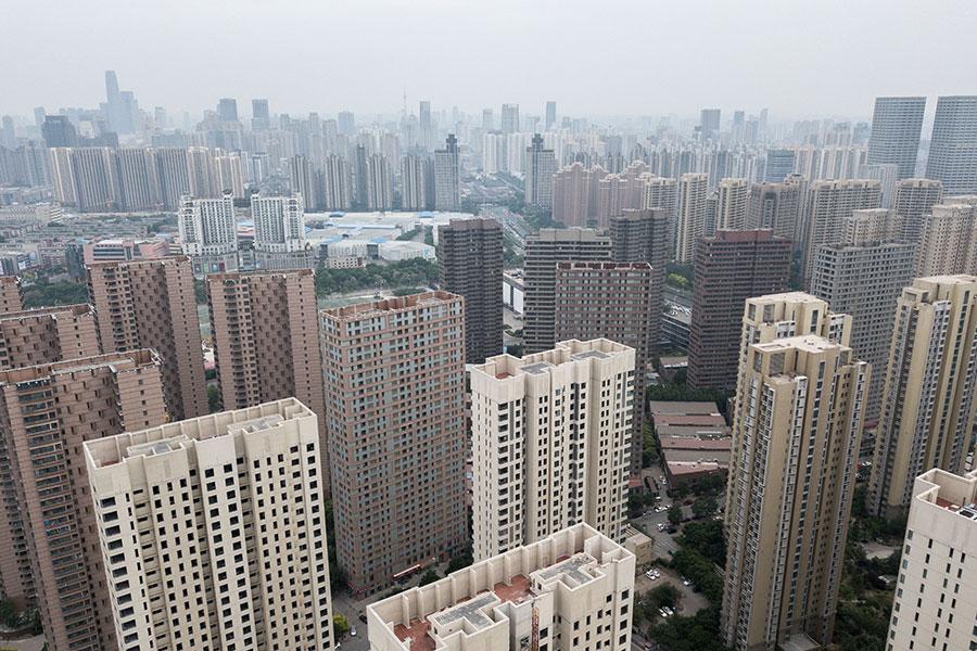 標普全球評級3日表示,中國大陸融資環境收緊,房地產開發商面臨考驗。圖為天津市一景。(FRED DUFOUR/AFP/Getty Images)