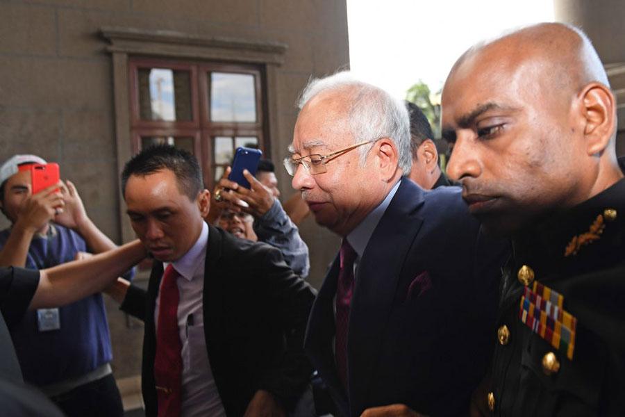 由馬哈蒂爾發起的對一馬國家基金的調查導致前總理納吉周二被捕。(MOHD RASFAN/AFP/Getty Images)