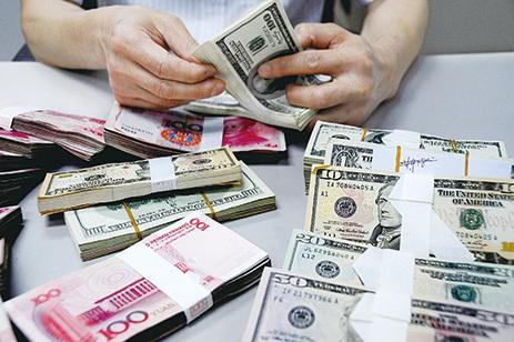 有法媒分析說,北京的無形之手正在操縱人民幣的匯率。(Getty Images)