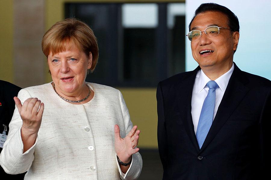 近日,中共國務院總理李克強訪德,雙方簽署近300億美元交易。(FABRIZIO BENSCH/AFP/Getty Images)