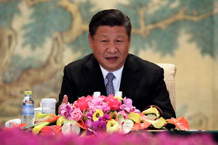中共黨媒罕見一周內兩天在頭版標題中沒有提習近平,與此同時華國鋒犯錯被再報道。如此罕見現象引發外界懷疑北京再次發生權鬥。(Andy Wong – WPA Pool/Getty Images)