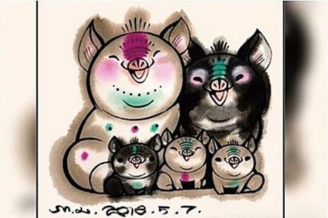 在今年的中國豬年特別版郵票上,上面有豬爸爸、豬媽媽和三個豬寶寶。(影片截圖)