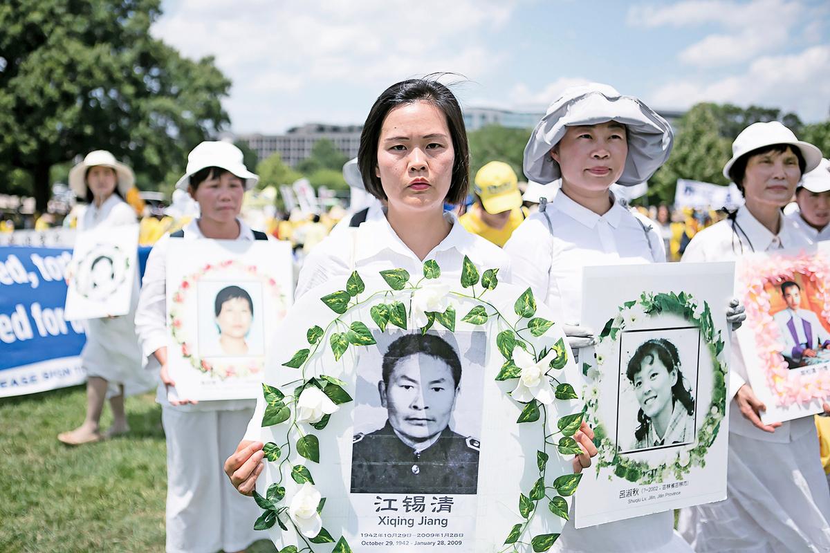 2016年7月14日,法輪功學員江莉參加在華盛頓DC舉行的反迫害、九評退黨集會。(李莎/大紀元)