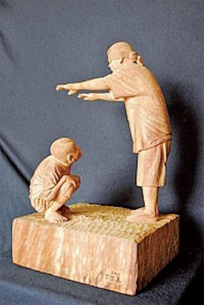 丁宗華木雕作品〈尋〉,在困難中找到了光明的出口。